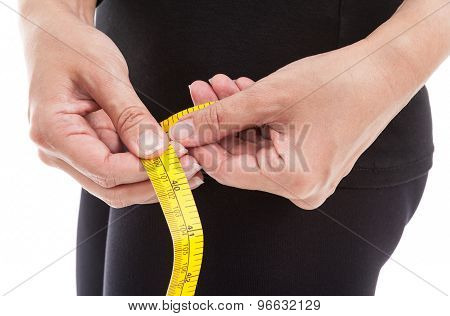 The Woman In Black Clothes Measuring Her Hip With Measuring Tape On White Background.