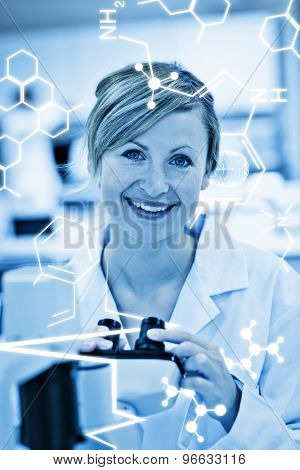 Science graphic against joyful female scientist using a microscope