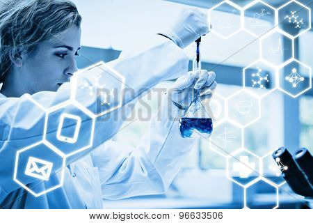 Science graphic against cute science student putting blue drops in a liquid