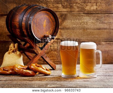 Glasses Of Beer With Wooden Barrel