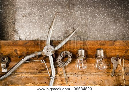 Pliers, Bulbs, Rope, Key, Hanging On Nails On The Old Wooden Stand