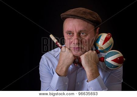Portrait of mature musician with Ukrainian woodwind instrument sopilka