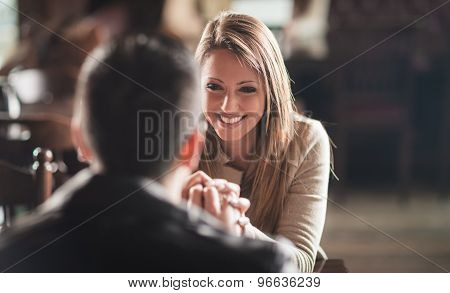 Romantic Couple Holding Hands At The Bar