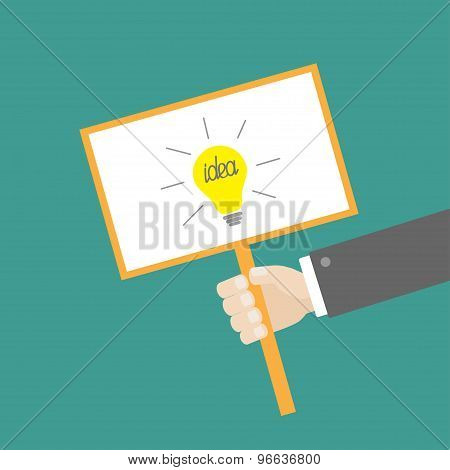 Businessman Hand Holding Paper Blank Sign Plate With Idea Light Bulb On The Stick Flat Design
