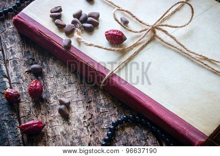 Corded Book With Beads, Dogrose, Pine Nuts