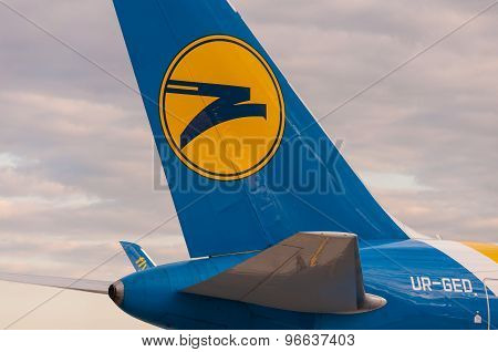 KIEV, UKRAINE - JULY 10, 2015: Aircraft Tail with logo sign of Ukraine international airlines in Bor