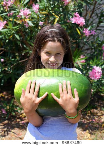 Smiling Little Girl With An Enormous Watermelon
