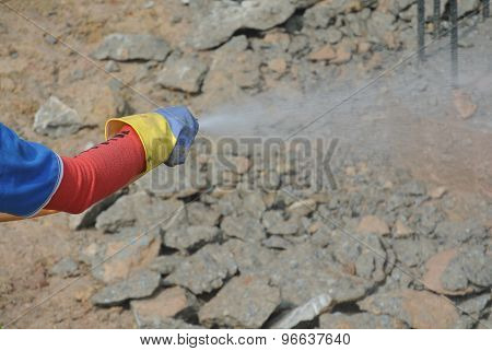 Construction workers spraying the anti termite chemical treatment to the pile cap