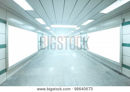 Bright Underpass With Blank Billboard Advertising Wall