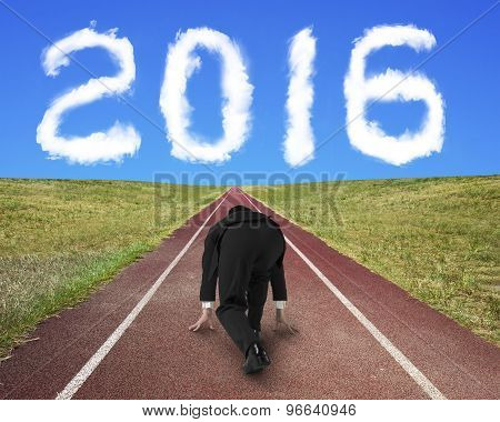 Businessman Ready To Race On Running Track Toward 2016 Cloud