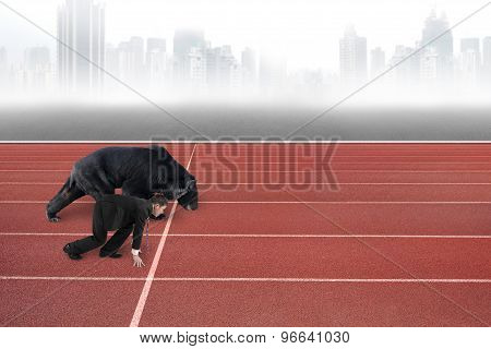 Businessman And Bear Are Ready To Race On Running Track