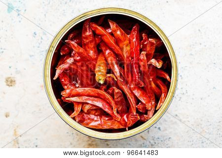 Indian Spice ingredient ~ Closeup of freshly dried red chillies kept in a container