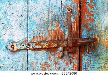 Old tacky blue door with vintage lock, wooden texture