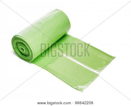 Roll of green plastic trashbags isolated on white with naturan shadow.