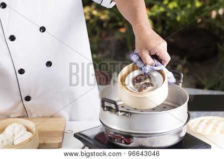 Chef Cooking Dumpling With Streamed Pot