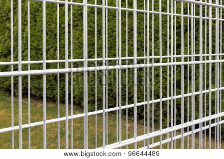 Iron bars of an empty gabion wall