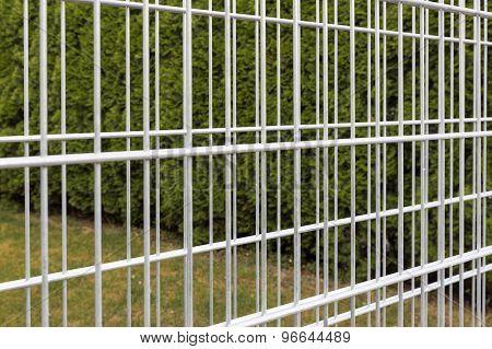 Iron bars of an empty gabion wall