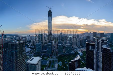 Panoramic skyline and urban cityscape at sunset