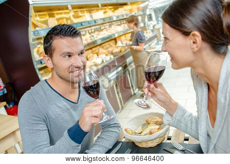 Couple drinking red wine with a meal