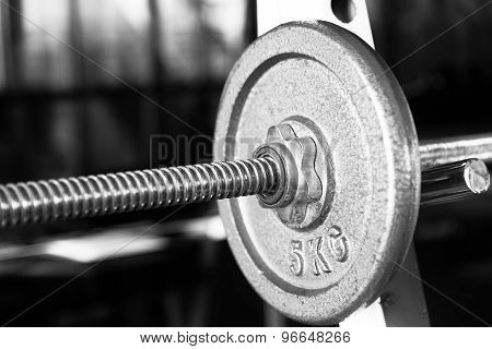 Barbell Focused On 5 Kg Plate Black And White
