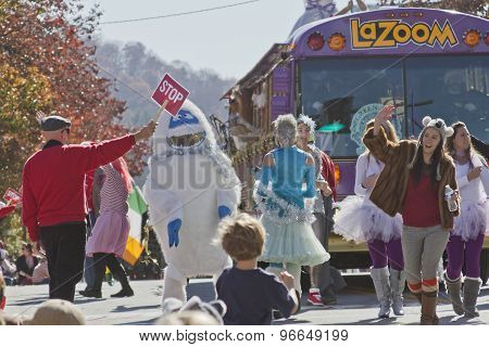 Lazoom Bus Characters Frolick In The Asheville Christmas Parade