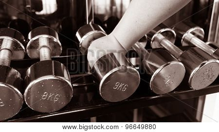 Chubby Man Holding Rustic Dumbell Copper Black And White