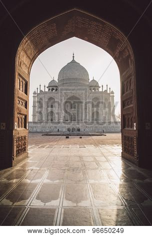 View of Taj Mahal from mosque with sun reflection. West side. Post-processed with grain, texture and colour effect.