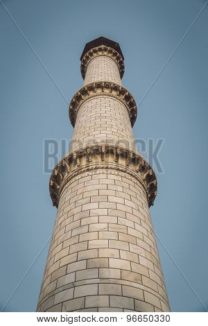 One of four minaret towers of the Taj Mahal.  Post-processed with grain, texture and colour effect.