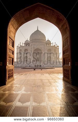View of Taj Mahal from mosque with sun reflection. West side.