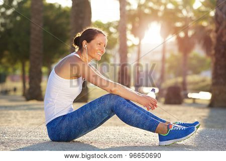 Sports Woman Sitting Outside Smiling