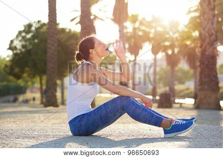 Female Runner Drinking Water After Exercise