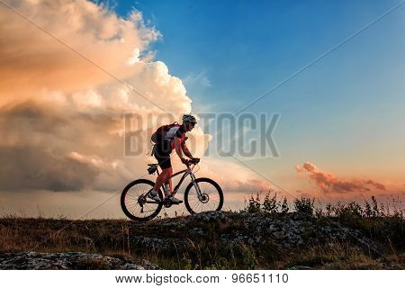 Biker riding on bicycle in mountains