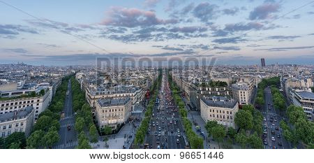 Skyline of Paris with Champs-Elysees at sunset
