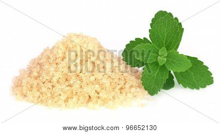 Coarse Crystals Of Brown Sugar With Stevia Leaves