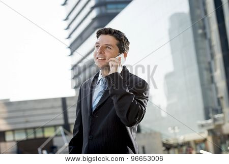 Businessman In Suit And Necktie Talking On Mobile Phone Smiling Happy And Confident Standing Outdoor