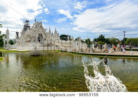 Tourist seeing Wat Rong Khun The famous white temple in the Chiang Rai Thailand