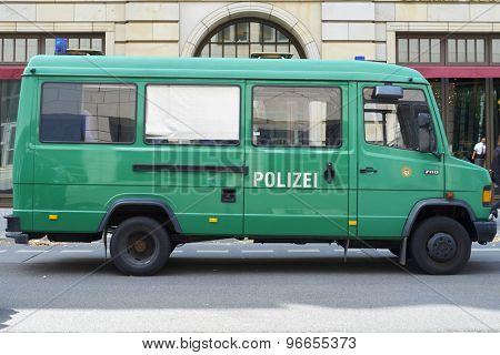 BERLIN, GERMANY - JULY 08: Empty green police van parked in the street. July 08, 2015 in Berlin.