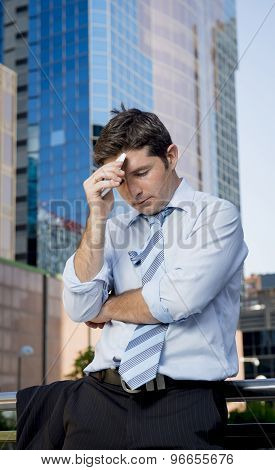 Tired And Overworked Businessman Holding Mobile Phone Worried In Stress