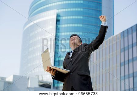 Successful Businessman With Computer Laptop Happy Doing Victory Sign