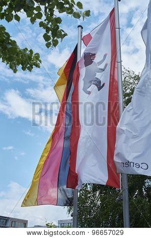 BERLIN, GERMANY - JULY 08: City of Berlin banner blowing in the wind next to German banner. July 08, 2015 in Berlin.