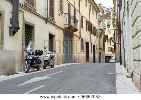 VERONA, ITALY - JULY 13: Low angle shot of street with scooters parked. July 13, 2015 in Verona.