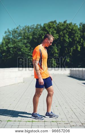 Sport And Healthy Lifestyle Concept - Sporty Fitness Runner Man Standing In The City Over Sky, Ready