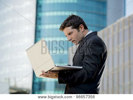Young Businessman Holding Computer Laptop Working Urban Business Outdoors