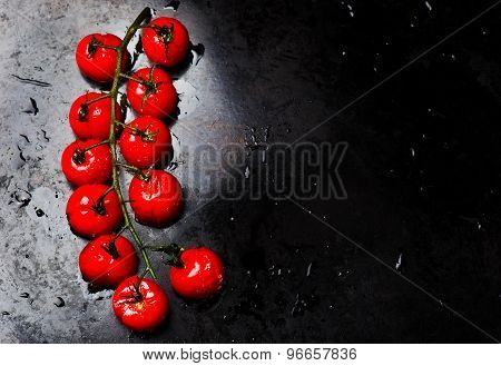 The Baked Cherry Tomatoes On A Baking Sheet.