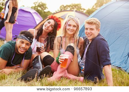 Group of friends hanging out at a music festival campsite