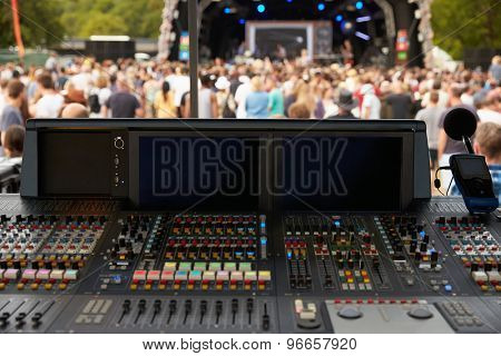 Sound and lighting desk at an outdoor festival concert