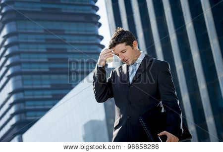 Young Exhausted And Worried Businessman Standing Outdoors In Stress And Depression