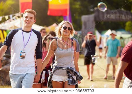 Couple walking through music festival