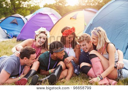 Friends having fun on the campsite at a music festival