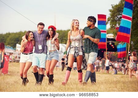 Friends walking through a music festival site